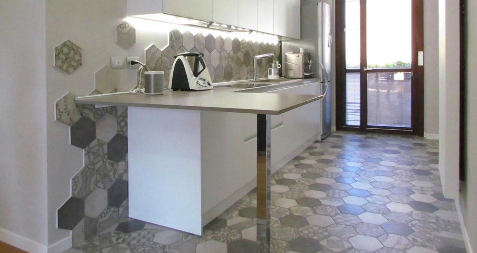 A kitchen decorated with cement tiles